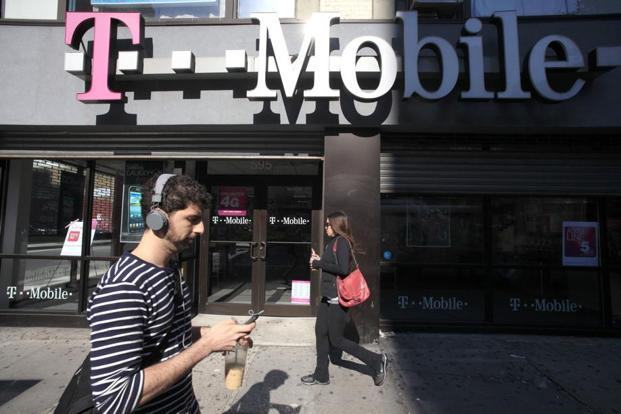 A tie-up between Sprint and T-Mobile would cut the number of national wireless carriers to three from four in the United States. Photo: AP