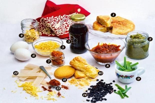 1. 'Dar ni Pori'; 2. Green masala; 3. Matured sugarcane vinegar; 4. Fried cashews; 5. 'Sali'; 6. Eggs; 7. Homemade curry masala; 8. 'Lagan nu achaar'; 9. Lemongrass; 10. 'Khari' biscuits; 11. Shrewsbury biscuits; 12. 'Saria papad'; 13. 'Dhansak' masala; and 14. Zereshk berries. Photo: Aniruddha Chowdhury/Mint (Aniruddha Chowdhury/Mint)