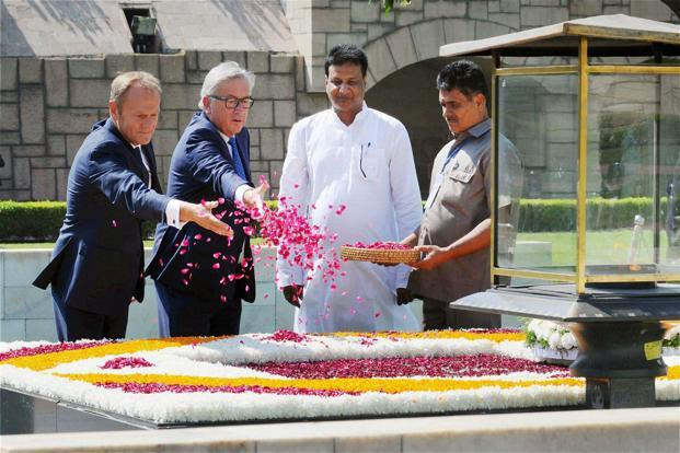 European Council president Donald Tusk and the European Commission chief Jean-Claude Juncker paying tribute to Mahatma Gandhi, in Delhi on Friday. Photo: PTI (PTI)