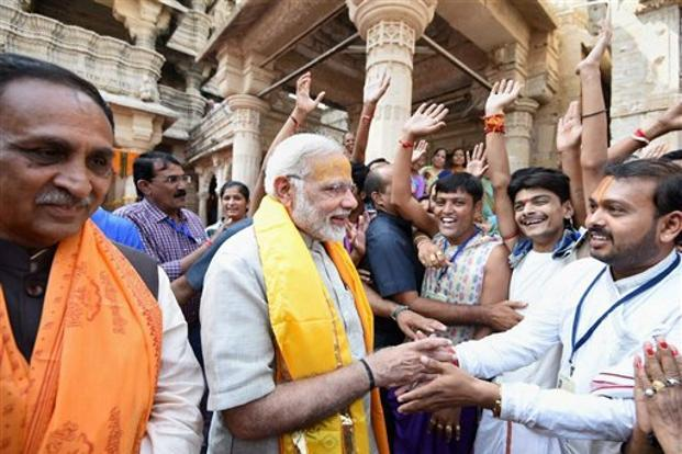 Earlier in the day, PM Narendra Modi took a jibe at rival Congress at a function in the temple town of Dwarka where he said that the definition of development amounted to making cheap publicity stunts to win elections. Photo: PTI (PTI)