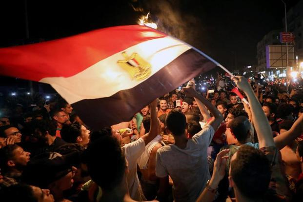 Egyptians celebrate their victory in a football match against Congo that qualifies Egypt for the World Cup, in Cairo, on 8 October. Photo: Reuters