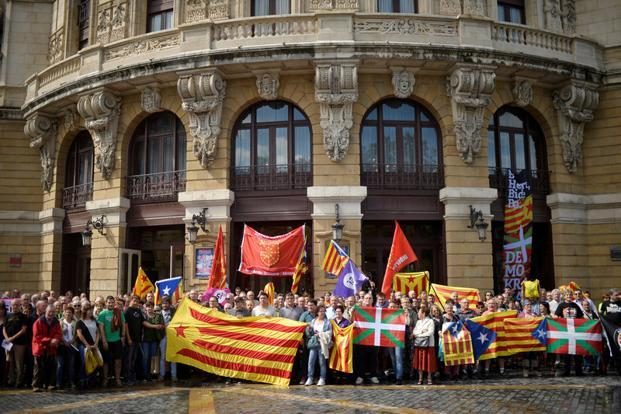 Protesters hold a rally in favour of a referendum on independence from Spain for the autonomous community of Catalonia, in the Basque city of Bilbao, Spain on Monday. Photo: Reuters (Reuters)