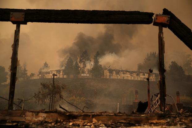 Smoke continues to rise from the Hilton Sonoma Wine Country on Monday in Santa Rosa, California. Photo: AFP (AFP)
