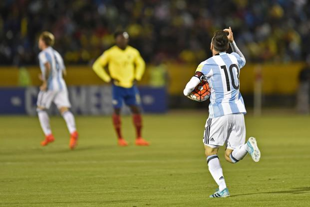 Lionel Messi celebrates after scoring against Ecuador during their 2018 World Cup qualifier football match in Quito, on 10 October. Photo: AFP