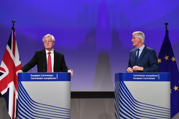 British secretary of state for exiting the European Union (Brexit minister) David Davis (L) and European Union chief negotiator in-charge of Brexit negotiations with Britain Michel Barnier address media representatives at the European Union Commission in Brussels on Thursday. Photo: AFP