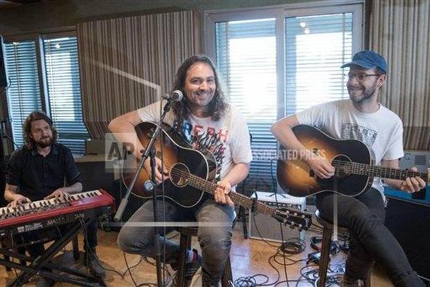 (from left) Keyboardist Robbie Bennett, vocalist Adam Granduciel and bassist David Hartley from The War on Drugs. Photo: AP