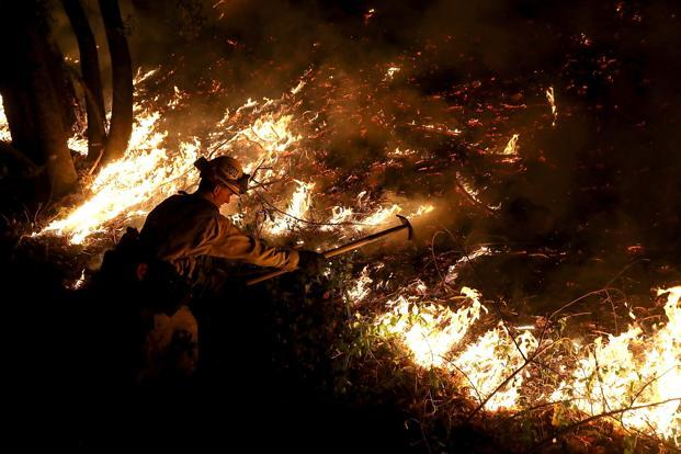 A firefighter is battling with wildfire Calistoga, California on Thursday. Photo: AFP