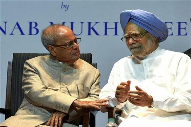 Former President Pranab Mukherjee with former prime minister Manmohan Singh at the release of his book The Coalition Years at a function in New Delhi on Friday. Photo: PTI
