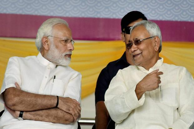 Prime Minister Narendra Modi with Bihar CM Nitish Kumar at the centenary celebrations of Patna University, in Patna, on Saturday. Photo: PTI