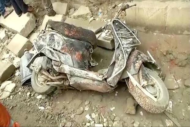 A damaged scooter at the site of the building collapse in Bengaluru.