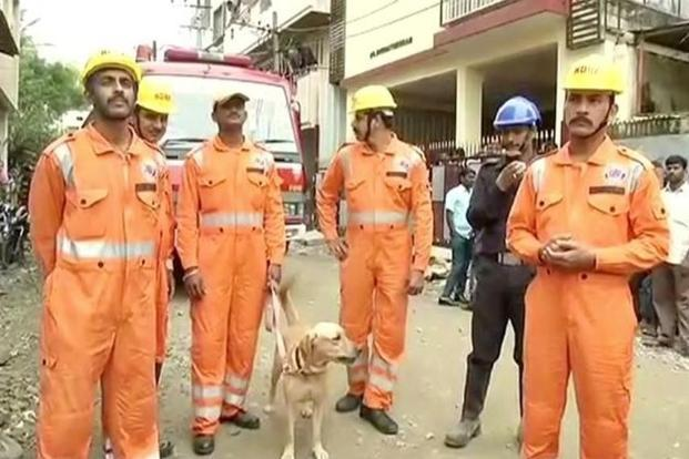 At least 40 fire-fighters and National Disaster Response Force personnel were carrying out rescue operation on Monday. Photos: ANI/Reuters