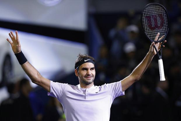 Roger Federer celebrates after defeating Rafael Nadal in the final of the Shanghai Masters, on Sunday. Photo: AP