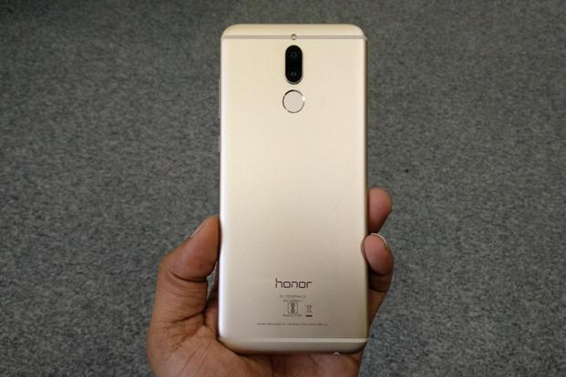The Honor logo that usually occupies the front bezel under the screen is placed on the back in this case.