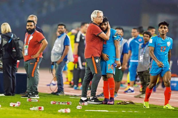 India's coach Luis Norton de Matos hugs Rahim Ali after India lost their Fifa Under-17 World Cup match against Colombia in New Delhi on 9 October. Photo: AP