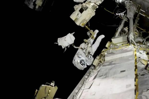 Nasa astronauts fix robotic arm on space station in time to grab next cargo ship