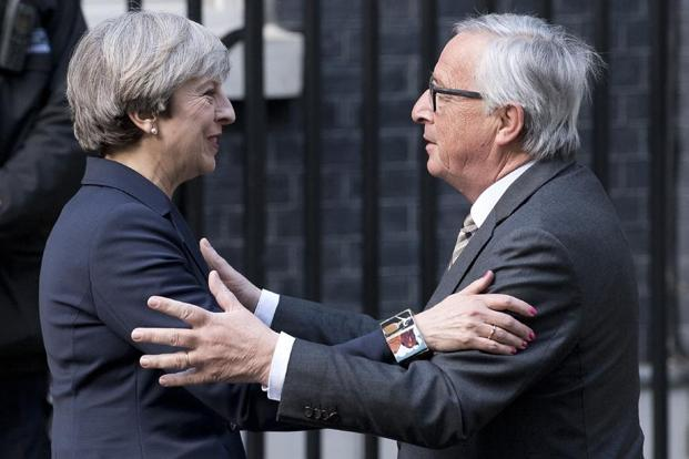 A file photo of European Commission president Jean-Claude Juncker with British Prime Minister Theresa May. Photo: AFP