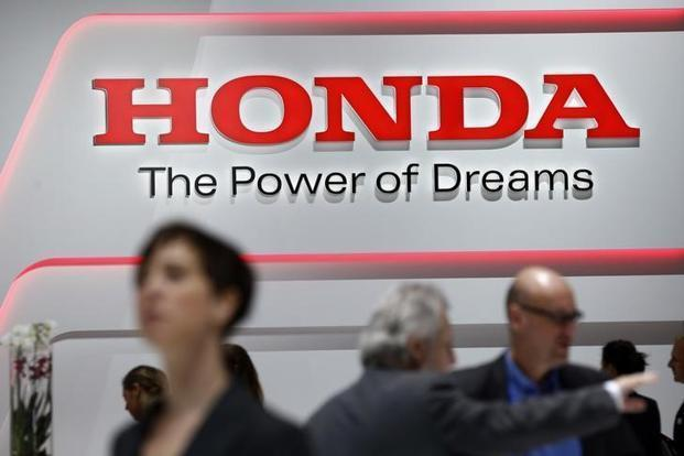 Honda Motor will clear cost-related hurdles for compact EVs and study better ways to produce them, said CEO Takahiro Hachigo. Photo: Reuters