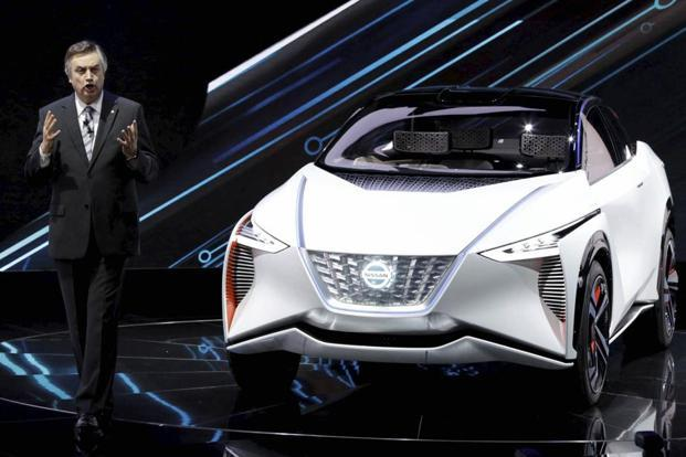 Daniele Schillaci, head of Nissan's global sales and marketing division, presents a Nissan IMx EV concept car during Tokyo Motor Show in Tokyo on Wednesday. Photo: AP
