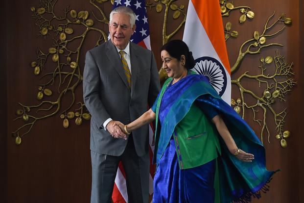 Foreign minister Sushma Swaraj (right) shakes hand with US Secretary of State Rex Tillerson before a meeting in New Delhi on 25 October 2017. Photo: AFP