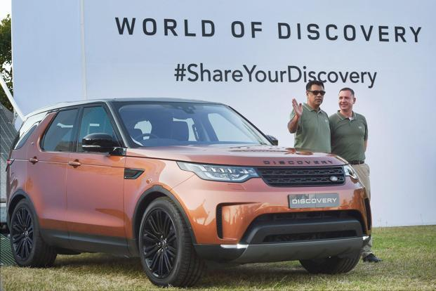 Rohit Suri (left) MD & president of Jaguar Land Rover India during the launch of new Land Rover Discovery in Mumbai on Saturday. Photo: PTI