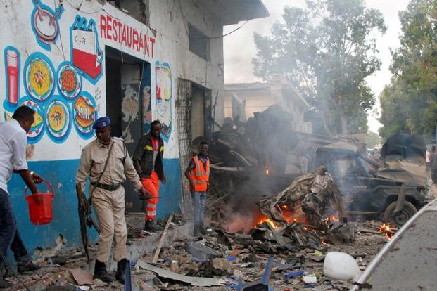 Somali security officers secure the scene of a suicide bomb explosion, at the gate of Naso Hablod Two Hotel in Hamarweyne district of Mogadishu, Somalia on Saturday. Photo: Reuters