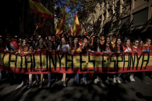Demonstrators hold a banner reading 'Catalonia is Spain' during a rally against Catalonia's declaration of independence, in Barcelona. AP