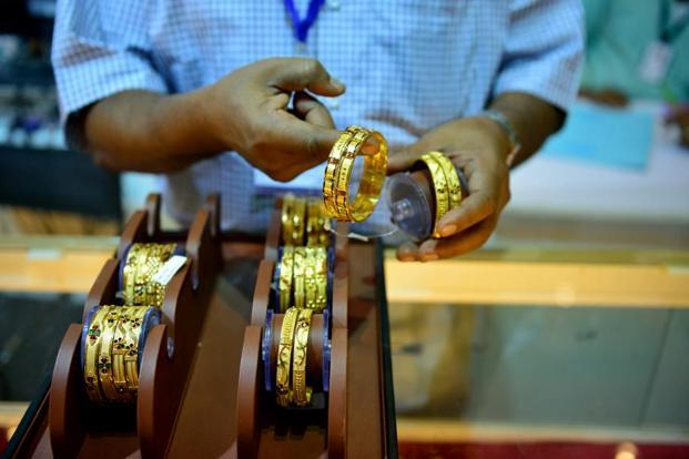 Pure gold (99.9 purity) also moved up by the same margin to finish at Rs29,390 per 10 grams compared to Rs29,375 in Mumbai. Photo: Pradeep Gaur/Mint