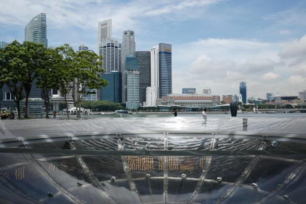 Singapore's industry transformation map aims to achieve growth in financial sector real value-added of 4.3% annually, and to create 3,000 net jobs in financial services, and 1,000 net jobs in the fintech sector annually. Photo: Reuters