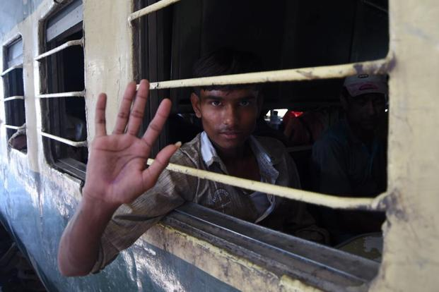 A fishermen released from Malir jail waves from a train at a railway station in Karachi on Sunday. AFP