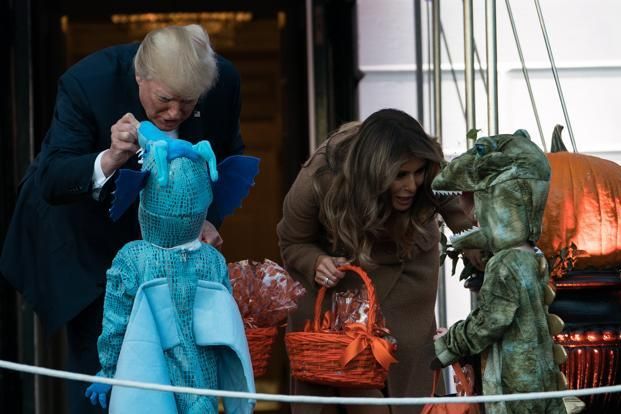 US President Donald Trump and first lady Melania Trump hand out candy to children during a Halloween event at the White House in Washington, DC, on Monday. Photo: AFP