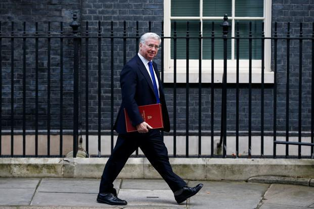 UK defence secretary Michael Fallon had apologized earlier this week for repeatedly touching a radio presenter's knee in 2002. Photo: Reuters