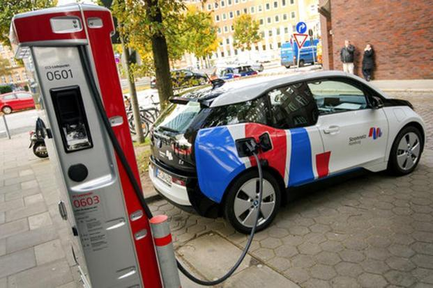 Through 2018, the companies will expand the network to more than 100 sites to ease concern among drivers of electric cars over ending up stranded on long trips. Photo: AP
