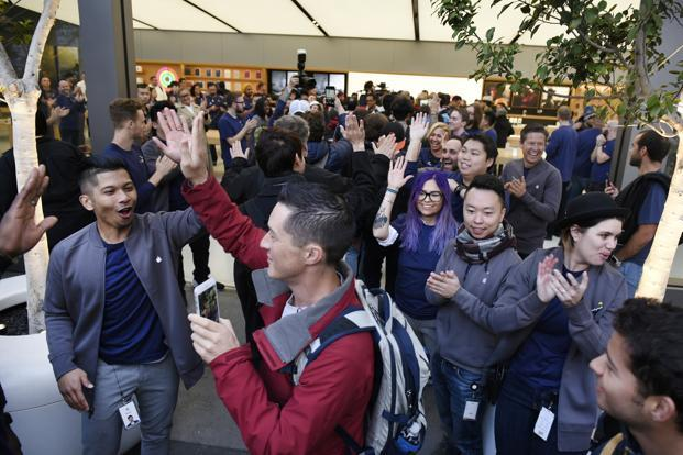 Apple employees greet customers entering the store during the sales launch for iPhone X in San Francisco, on Friday. Photo: Bloomberg