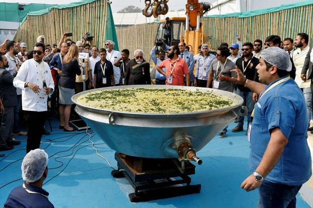 Around 800kg of Khichdi was cooked in a giant wok at the World Food India 2017 festival in New Delhi on Saturday to create a world record and popularise it as Brand India food. Photo: PTI
