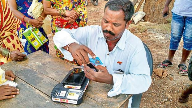 A fair price shop owner in Ibrahimpur, which shot to fame as the first cashless village in south India, using a PoS machine. Photo: Yunus Y. Lasania/Mint