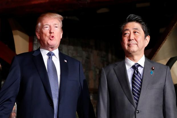 US President Donald Trump and Japan's prime minister Shinzo Abe (right) meet for a dinner at a restaurant in Tokyo on Sunday. Photo: Reuters