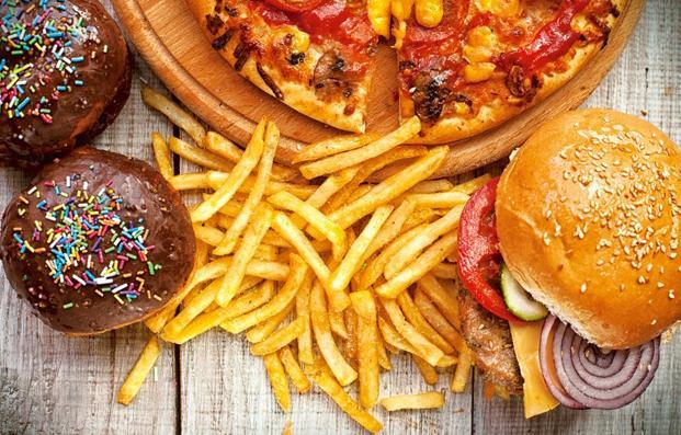 Cut down on junk food like pizzas and donuts. Photo: iStockphoto