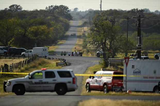 Law enforcement set up a cordon along an intersection in the aftermath of a mass shooting in Sutherland Springs, Texas, on Sunday. Photo: Reuters