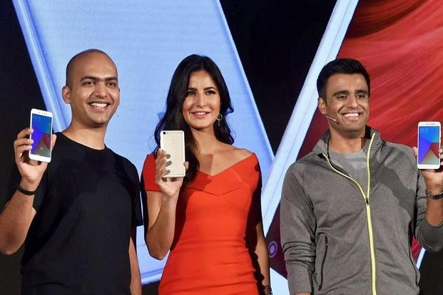 Xiaomi holds the fifth position with market share of 7.4%, but it registered the highest year-on-year growth of 102.6% from Q3 2016 when it controlled only 3.7% of the market share. (Above) Xiaomi's India head Manu Jain (left) with actor Katrina Kaif during the launch of its new series of smartphones, in New Delhi on Thursday. Photo: PTI