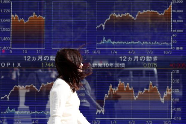 Japanese stocks are currently trading at 14-times their projected earnings, compared with a much more aggressive valuation of 37.73-times their projected earnings in 1992. Photo: Reuters