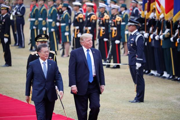 US President Donald Trump walks with South Korea's president Moon Jae-in during a welcoming ceremony at the Presidential Blue House in Seoul, South Korea, on Tuesday. Photo: Reuters