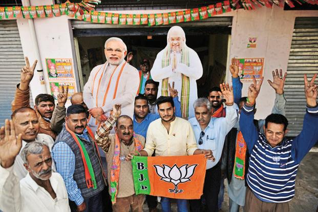 BJP supporters at Kangra in Himachal Pradesh. Kangra holds 15 assembly seats and is instrumental in determining who rules the state. Photo: Pradeep Gaur/Mint