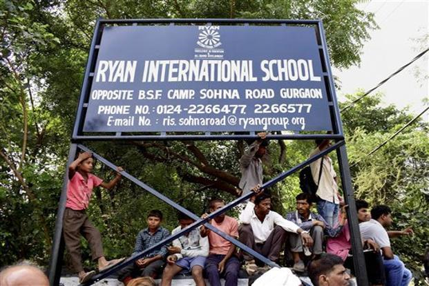 Demonstrators protest outside Ryan International School in Gurgaon as they demand action against the school. File photo: PTI