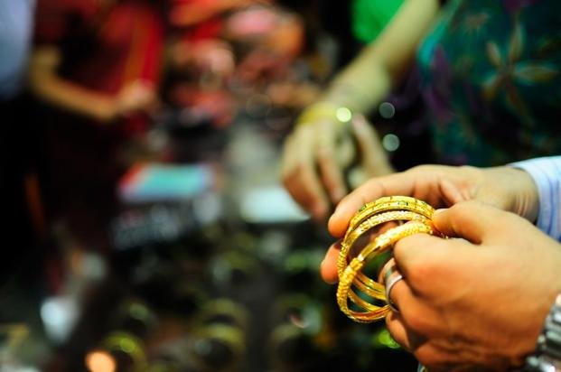 Pure gold (99.9% purity) also moved up by the same amount to Rs29,535 per 10 grams as against Rs29,480 previously in Mumbai. Photo: Pradeep Gaur/Mint
