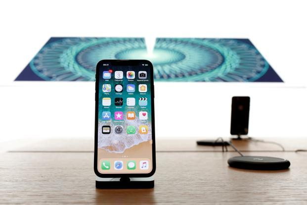 Apple's iPhone X includes a stainless steel case, a 3-D facial recognition system on the front, and a 5.8-inch OLED screen that aren't part of the iPhone 8. Photo: Reuters