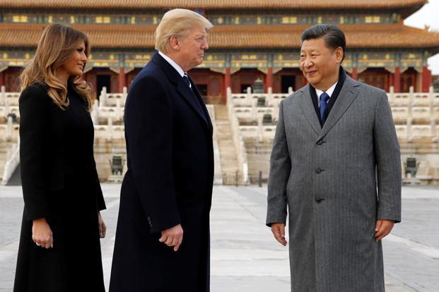 US President Donald Trump and First Lady Melania Trump with Chinese President Xi Jinping in Beijing. Photo: Reuters