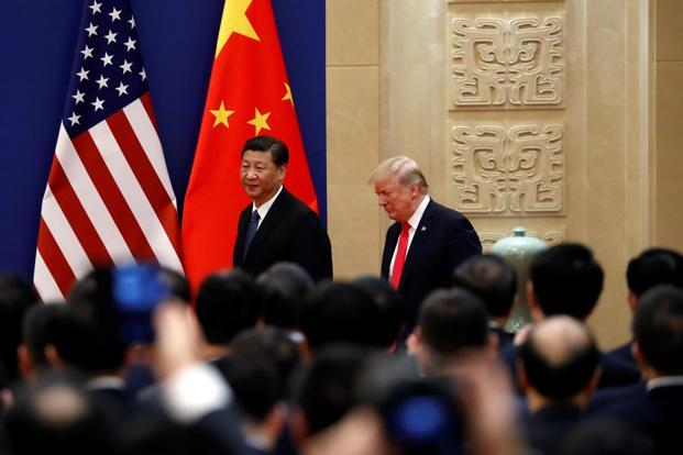US President Donald Trump (right) and China's President Xi Jinping meet business leaders at the Great Hall of the People in Beijing. Photo: Reuters