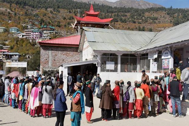 Voters outside a polling both in Khwangi village of Kinnaur, Himachal Pradesh, on Thursday. Photo: PTI