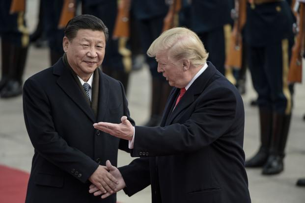 China's president Xi Jinping and US President Donald Trump attend a welcome ceremony at the Great Hall of the People in Beijing on Thursday. Photo: AFP