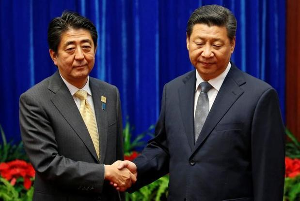 China's statement about the meeting cited Xi Jinping (right) as telling Shinzo Abe that stable relations were in both sides' interests, and that they must make unremitting efforts to continue improving ties. Photo: Reuters